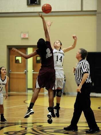 Central  player Alexandria Hailey, #42, wins the tip over Blair Richmond, #14, during the Vidor High School Lady Pirates basketball game against the Central High School Lady Jaguars on Tuesday, January 8, 2013 at Vidor High School. Vidor won over Central 65 - 60. Photo taken: Randy Edwards/The Enterprise Photo: Randy Edwards