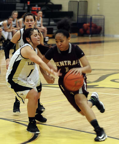 Central player Malena Washington, #1, drives down the court during the Vidor High School Lady Pirates basketball game against the Central High School Lady Jaguars on Tuesday, January 8, 2013 at Vidor High School. Vidor won over Central 65 - 60. Photo taken: Randy Edwards/The Enterprise Photo: Randy Edwards