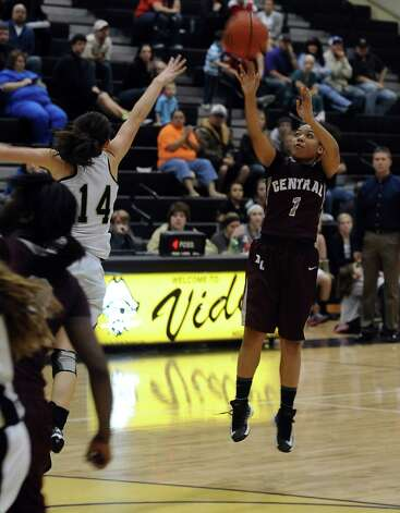 Central player Malena Washington, #1, puts it up for three during the Vidor High School Lady Pirates basketball game against the Central High School Lady Jaguars on Tuesday, January 8, 2013 at Vidor High School. Vidor won over Central 65 - 60. Photo taken: Randy Edwards/The Enterprise Photo: Randy Edwards