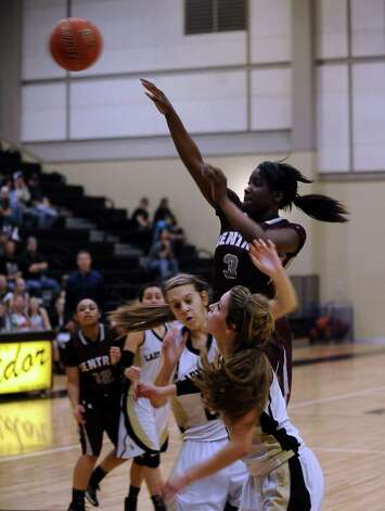 Central player Rondaysha Thomas, #3, puts it up for two during the Vidor High School Lady Pirates basketball game against the Central High School Lady Jaguars on Tuesday, January 8, 2013 at Vidor High School. Vidor won over Central 65 - 60. Photo taken: Randy Edwards/The Enterprise Photo: Randy Edwards