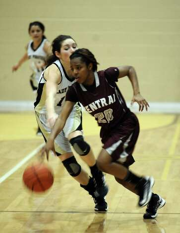 Central player Talitha Savoy, #20, steals the ball during the Vidor High School Lady Pirates basketball game against the Central High School Lady Jaguars on Tuesday, January 8, 2013 at Vidor High School. Vidor won over Central 65 - 60. Photo taken: Randy Edwards/The Enterprise