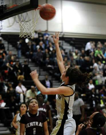 Vidor player Blair Richmond, #14, puts it up for two during the Vidor High School Lady Pirates basketball game against the Central High School Lady Jaguars on Tuesday, January 8, 2013 at Vidor High School. Vidor won over Central 65 - 60. Photo taken: Randy Edwards/The Enterprise