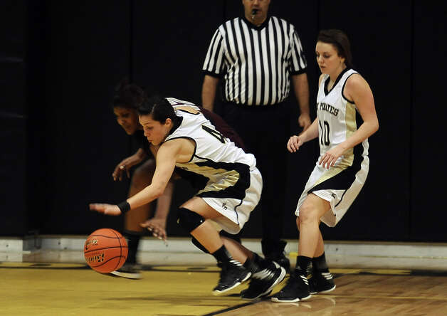Vidor player Tori Biddle, #4, steals the ball during the Vidor High School Lady Pirates basketball game against the Central High School Lady Jaguars on Tuesday, January 8, 2013 at Vidor High School. Vidor won over Central 65 - 60. Photo taken: Randy Edwards/The Enterprise Photo: Randy Edwards