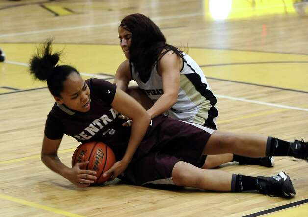 Central player Malena Washington, #1, fights Liana Rodriguez, #11, for the ball during the Vidor High School Lady Pirates basketball game against the Central High School Lady Jaguars on Tuesday, January 8, 2013 at Vidor High School. Vidor won over Central 65 - 60. Photo taken: Randy Edwards/The Enterprise Photo: Randy Edwards