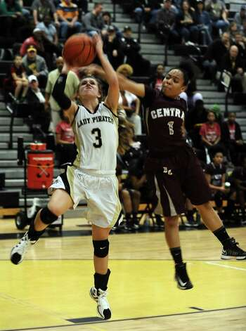 Vidor player Allison Jacks, #3, puts the ball up for two during the Vidor High School Lady Pirates basketball game against the Central High School Lady Jaguars on Tuesday, January 8, 2013 at Vidor High School. Vidor won over Central 65 - 60. Photo taken: Randy Edwards/The Enterprise