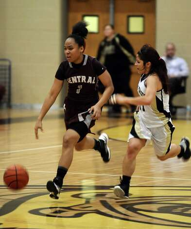 Central player Malena Washington, #1, drives down the court during the Vidor High School Lady Pirates basketball game against the Central High School Lady Jaguars on Tuesday, January 8, 2013 at Vidor High School. Vidor won over Central 65 - 60. Photo taken: Randy Edwards/The Enterprise