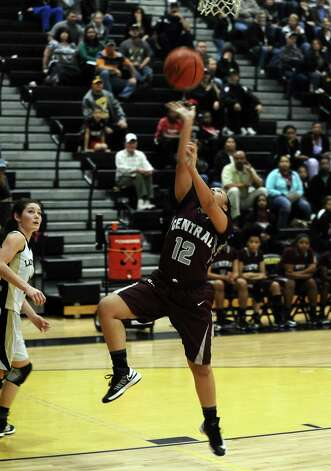 Central player Tierra Douglas, #12, puts it up for two during the Vidor High School Lady Pirates basketball game against the Central High School Lady Jaguars on Tuesday, January 8, 2013 at Vidor High School. Vidor won over Central 65 - 60. Photo taken: Randy Edwards/The Enterprise Photo: Randy Edwards