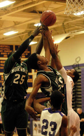 Norwalk's Steven Enoch, center, and Saeed Soulemane win the rebound as Westhill High School hosts Norwalk in a boys basketball game in Stamford, Conn., Jan. 8. 2013. Photo: Keelin Daly / Stamford Advocate Riverbend Stamford, CT