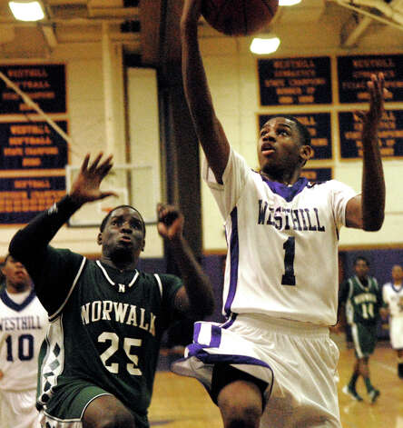 Westhill's Jeremiah Livingston shoots as Norwalk's Saeed Soulemane closes in as Westhill High School hosts Norwalk in a boys basketball game in Stamford, Conn., Jan. 8. 2013. Photo: Keelin Daly / Stamford Advocate Riverbend Stamford, CT