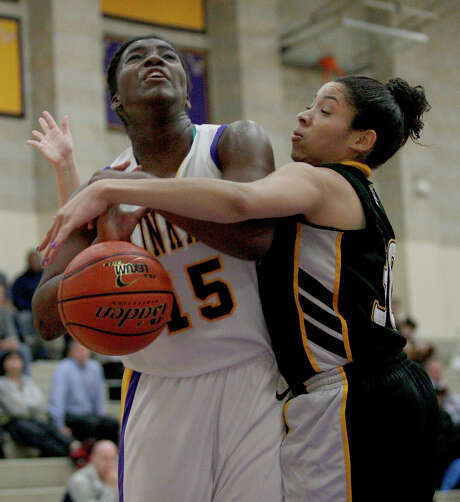 St. Agnes' Crystal Ike, right, knocks the ball away from Kinkaid's Tyjae Scales. Photo: Thomas B. Shea / © 2012 Thomas B. Shea