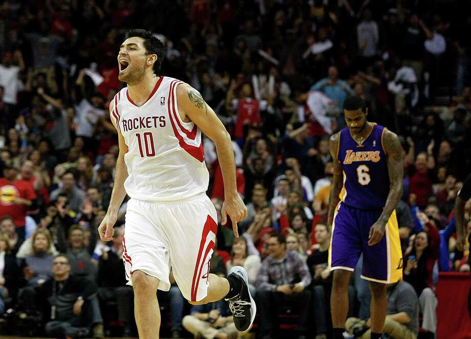 Houston Rockets small forward Carlos Delfino (10) celebrates making a three-point basket in the the fourth quarter as the Houston Rockets defeated the Los Angeles Lakers 112 to 125 at Toyota Center Tuesday, Jan. 8, 2013, in Houston. ( Johnny Hanson / Houston Chronicle ) Photo: Johnny Hanson, Staff / © 2012  Houston Chronicle