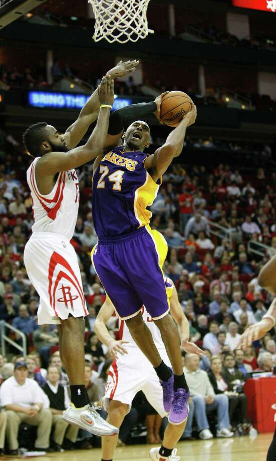 James Harden, left, outscored Kobe Bryant 31-20 and also received much more help from his friends than Bryant did from the shorthanded Lakers. Photo: Johnny Hanson, Staff / © 2012  Houston Chronicle