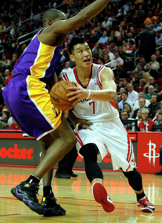 Rockets guard Jeremy Lin drives to the basket against Antawn Jamison of the Lakers. Photo: Johnny Hanson / © 2012  Houston Chronicle
