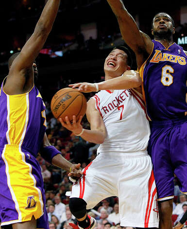 Rockets point guard Jeremy Lin is fouled while attempting a shot. Photo: Johnny Hanson / © 2012  Houston Chronicle