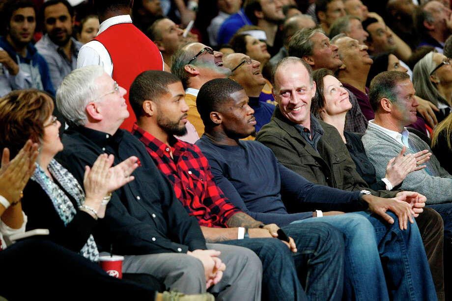 Arian Foster and Andre Johnson of the Texans sat courtside to see the Lakers and Rockets. Photo: Johnny Hanson / © 2012  Houston Chronicle