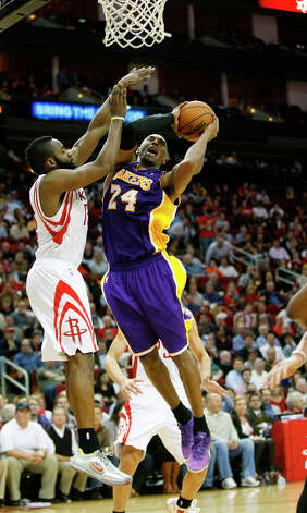 Rockets guard James Harden tries to force a bad shot by Lakers guard Kobe Bryant. Photo: Johnny Hanson / © 2012  Houston Chronicle