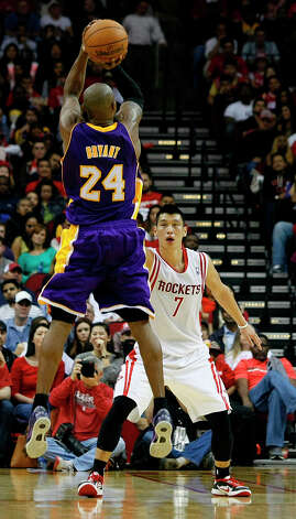 Lakers guard Kobe Bryant shoots over Jeremy Lin of the Rockets in the third quarter. Photo: Johnny Hanson / © 2012  Houston Chronicle