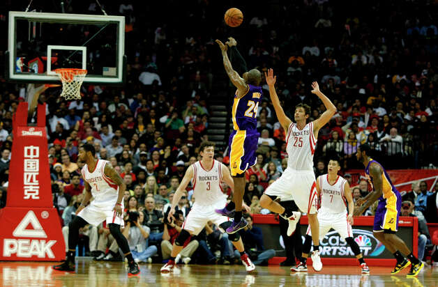 Lakers shooting guard Kobe Bryant attempts a shot over Rockets forward Chandler Parsons in the third quarter. Photo: Johnny Hanson / © 2012  Houston Chronicle