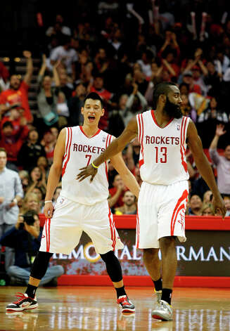 Rockets point guard Jeremy Lin celebrates a made 3-pointer in the third quarter as he and James Harden get back on defense. Photo: Johnny Hanson / © 2012  Houston Chronicle