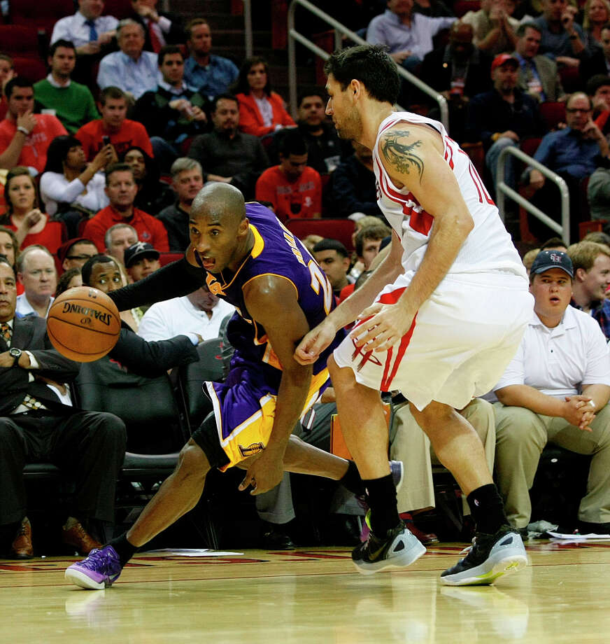 Rockets forward Carlos Delfino defends Kobe Bryant of the Lakers. Photo: Johnny Hanson / © 2012  Houston Chronicle