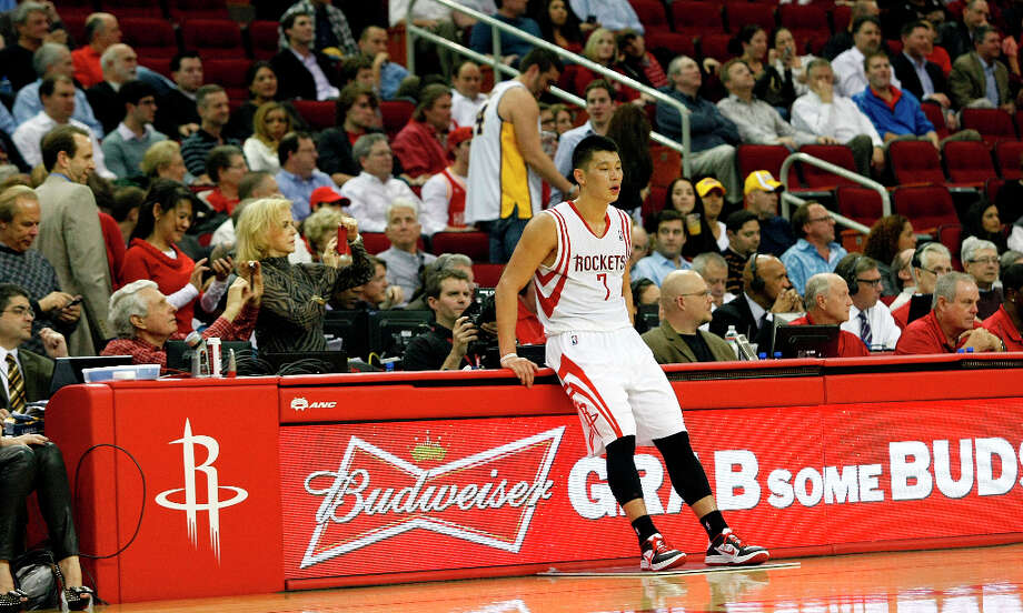 Houston Rockets point guard Jeremy Lin (7) waits to re-enter the game in the fourth quarter as the Houston Rockets defeated the Los Angeles Lakers 112 to 125 at Toyota Center Tuesday, Jan. 8, 2013, in Houston. Photo: Johnny Hanson / © 2012  Houston Chronicle