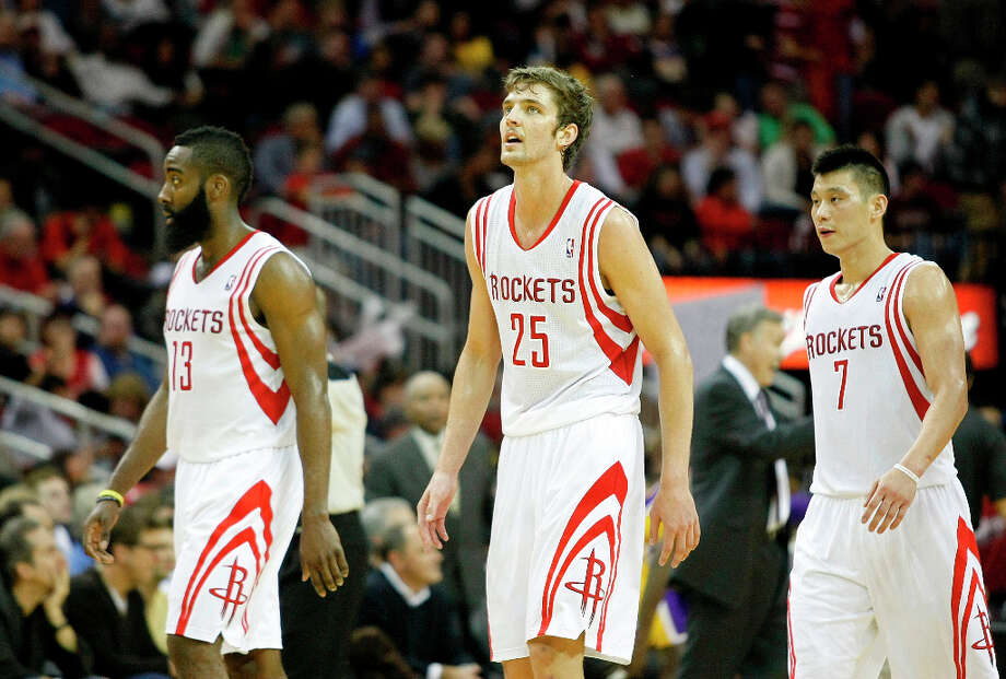 Houston Rockets shooting guard James Harden (13) Houston Rockets small forward Chandler Parsons (25) and Houston Rockets point guard Jeremy Lin (7) walk back to the bench in the fourth quarter as the Houston Rockets defeated the Los Angeles Lakers 112 to 125 at Toyota Center Tuesday, Jan. 8, 2013, in Houston. Photo: Johnny Hanson / © 2012  Houston Chronicle