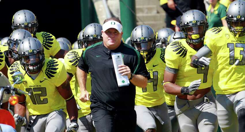 2. Oregon: Chip Kelly has officially returned, meaning the Ducks retain their most important element from this season's 12-1 team that didn't lose in regulation. The defense will be tougher with another year together, and the Ducks will have the Pac-12's most explosive offense with Marcus Mariota and De'Anthony Thomas back. PHOTO: Kelly runs on to the field with his team before the start of a game against Nevada, Sept. 10, 2011, in Eugene, Ore. Oregon defeated Nevada 69-20.