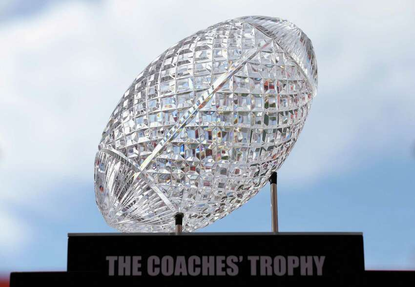 Express-News college football writer Tim Griffin projects his early Top 25 for 2013: PHOTO: The National Championship trophy sits on display during Media Day ahead of the Discover BCS National Championship at Sun Life Stadium on Jan. 5, 2013, in Miami Gardens, Fla.