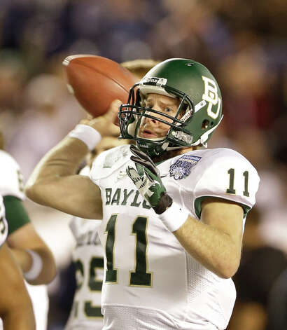 Who needs RG3? Baylor punctuated its torrid finish with a 49-26 thumping of UCLA in the Holiday Bowl. Nick Florence became the Bears' single-season passing leader, eclipsing Robert Griffin III. Phil Bennett's defense saved its best for last, notching six sacks and limiting UCLA to 33 rushing yards. PHOTO: Florence throws during the first half of the Holiday Bowl on Dec. 27, 2012 in San Diego. Photo: Lenny Ignelzi, Associated Press / AP