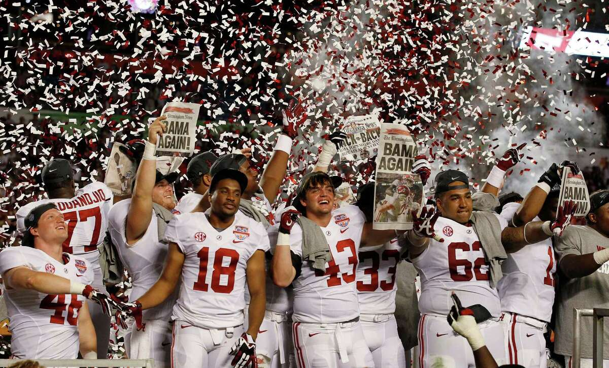 Express-News college football writer Tim Griffin looks back at the 2012-13 bowl season: Alabama players celebrate after the BCS National Championship college football game against Notre Dame Monday, Jan. 7, 2013, in Miami. Alabama won 42-14.
