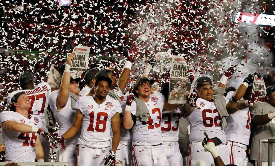 Express-News college football writer Tim Griffin looks back at the 2012-13 bowl season: Alabama players celebrate after the BCS National Championship college football game against Notre Dame Monday, Jan. 7, 2013, in Miami. Alabama won 42-14. Photo: Wilfredo Lee, Associated Press / AP