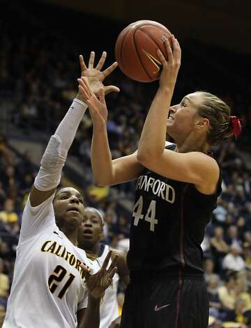 Stanford's Joslyn Tinkle tries to shoot over Cal's Reshanda Gray. Each player scored eight points. Gray and the Bears led by two at halftime, but the Cardinal took control in the second half. Photo: Lance Iversen, The Chronicle