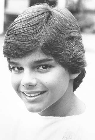 Then: Ricky Martin from his days in the boy band 'Menudo' Photo: FILE PHOTO