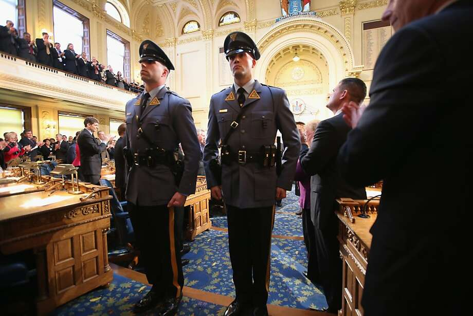New Jersey state troopers stand escort Governor Chris Christie after his State of the State Address on January 8, 2013 in Trenton, New Jersey. The popular Republican governor called on Congress to quickly approve more disaster aid for the state, more than two months after Hurricane Sandy. Photo: John Moore, Getty Images