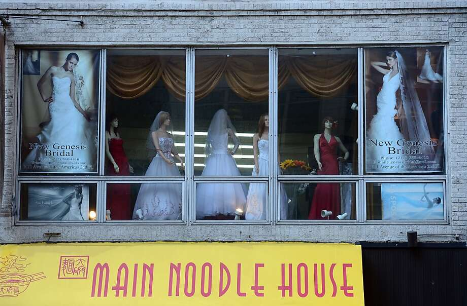 A bridal shop stands above an Asian noodle shop in New York, January 8, 2013. Photo: Emmanuel Dunand, AFP/Getty Images