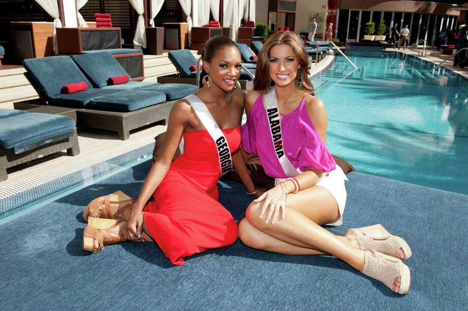 """Miss Georgia USA 2012, Jasmyn """"Jazz"""" Alexandria Wilkins; and Miss Alabama USA 2012, Katherine Webb; pose for a photo poolside at the Red Rock Hotel, Nevada on Tuesday, May 22, 2012. Photo: Darren Decker, Miss Universe Organization / Miss Universe Organization"""