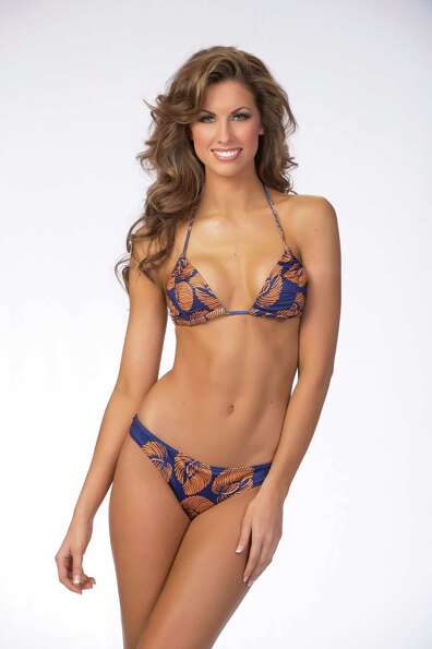 Miss Alabama USA 2012, Katherine Webb, poses for photographer in swimwear by Kooey Australia upon ar