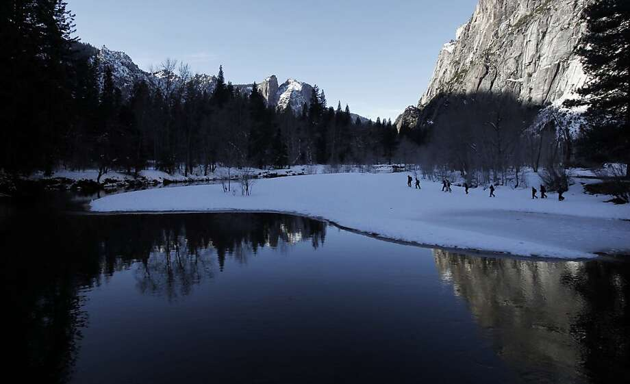 A group walks along the scenic Merced River close to its source, near Swinging Bridge in Yosemite Valley. Photo: Michael Macor, The Chronicle
