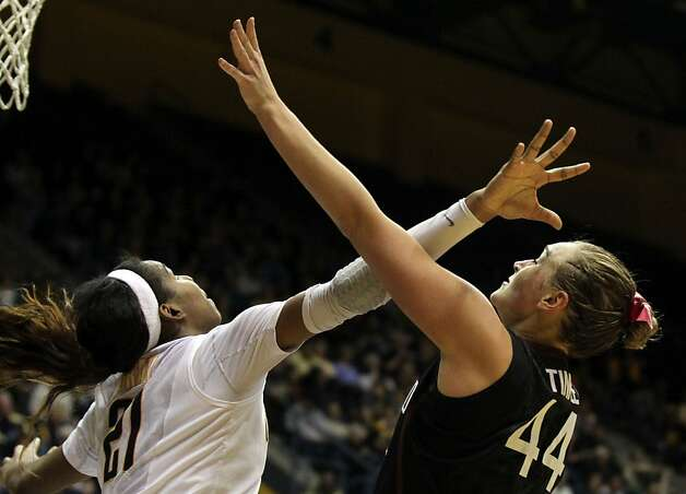 California forward Reshanda Grey (21) attempts to block a shot by Stanford forward Joslyn Tinkle (44) in the second half during an NCAA basketball game against Stanford Tuesday Jan 8, 1013, in Berkeley California. Stanford won 62-53 Photo: Lance Iversen, The Chronicle