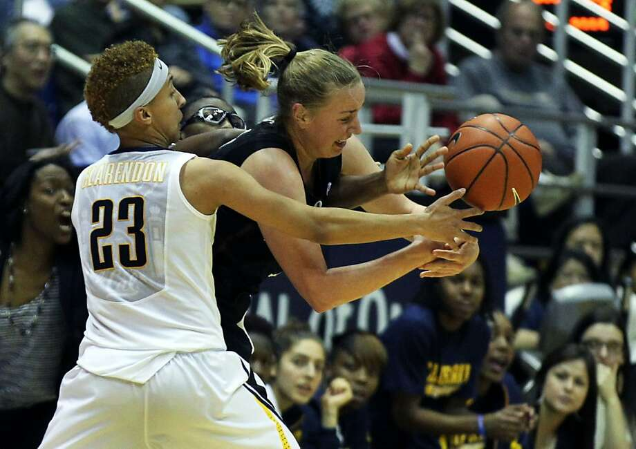 California guard Layshia Clarendon (23) takes the ball away from Stanford forward Mikaela Ruef in the first half during an NCAA basketball game Tuesday Jan 8, 1013, in Berkeley California. Photo: Lance Iversen, The Chronicle