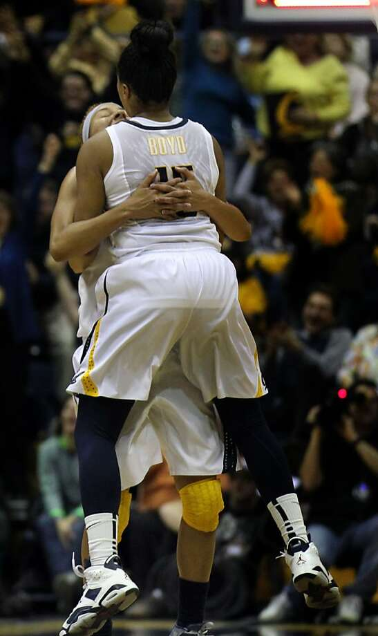 California guard Brittany Boyd (15) jumps into the arms of Layshia Clarendon (23) after the Bears took the lead at the half during an NCAA basketball game against Stanford Tuesday Jan 8, 1013, in Berkeley California. Photo: Lance Iversen, The Chronicle