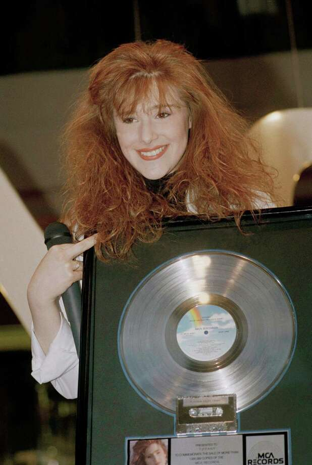 Then: Singer Tiffany poses with her platinum record on Jan. 27, 1989. Photo: Mark Terrill, AP / AP1989