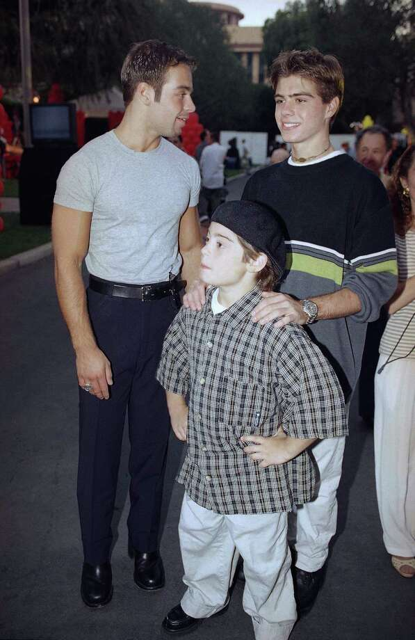 Then: Joey Lawrence (left) and his brothers Andy (center) and Matthew in 1997. Photo: AP