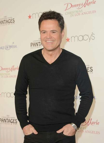 Now: Donny Osmond attends the 4th Annual National Believe Day at Macy's Pasadena on December 14, 201