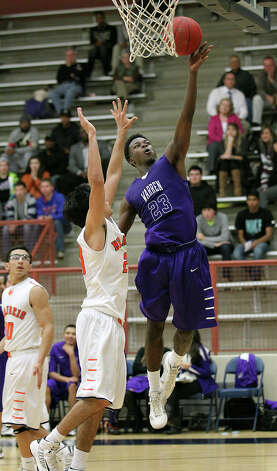 Warren's DeMarcus Garcia (23) goes up for a shot against Brandeis' Aaron Balderrama (20) during their game on Tuesday, Jan. 8, 2013. Brandeis defeated Warren, 56-48. Photo: Kin Man Hui, San Antonio Express-News / © 2012 San Antonio Express-News