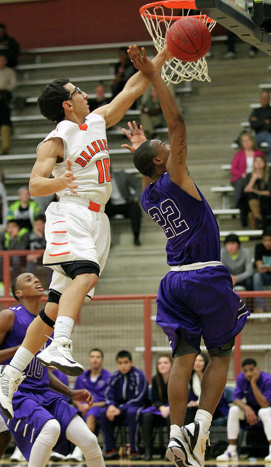 Brandeis' Shawn Guerrero (10) blocks a shot attempt by Warren's Avionte Sanders (22) during their game on Tuesday, Jan. 8, 2013. Brandeis defeated Warren, 56-48. Photo: Kin Man Hui, San Antonio Express-News / © 2012 San Antonio Express-News