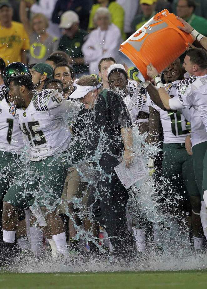 Oregon head coach Chip Kelly gets soaked by his players during the final seconds of the second half of the Fiesta Bowl NCAA college football game, Thursday, Jan. 3, 2013, in Glendale, Ariz. Oregon won 35-17. Photo: Matt York, Associated Press / AP