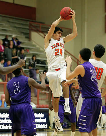 Brandeis' Grant Huff (24) grabs a rebound over Warren's Richard Hardy (03) and Anthony Trevino (20) during their game on Tuesday, Jan. 8, 2013. Brandeis defeated Warren, 56-48. Photo: Kin Man Hui, San Antonio Express-News / © 2012 San Antonio Express-News