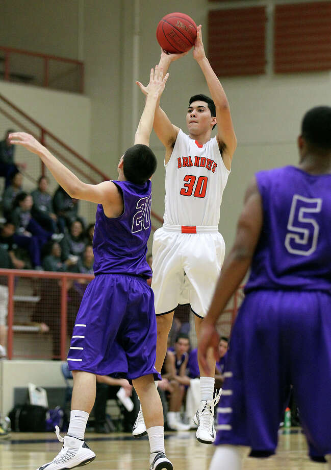 Brandeis' Matt Kallead (30) takes a shot over Warren's Anthony Trevino (20) during their game on Tuesday, Jan. 8, 2013. Brandeis defeated Warren, 56-48. Photo: Kin Man Hui, San Antonio Express-News / © 2012 San Antonio Express-News