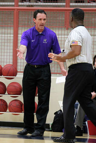 Warren basketball coach Jim Weaver questions a game official during their game against Brandeis on Tuesday, Jan. 8, 2013. Brandeis defeated Warren, 56-48. Photo: Kin Man Hui, San Antonio Express-News / © 2012 San Antonio Express-News